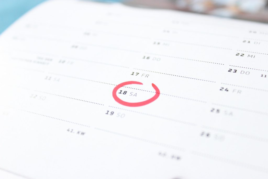 calendar with one day circled in red ink