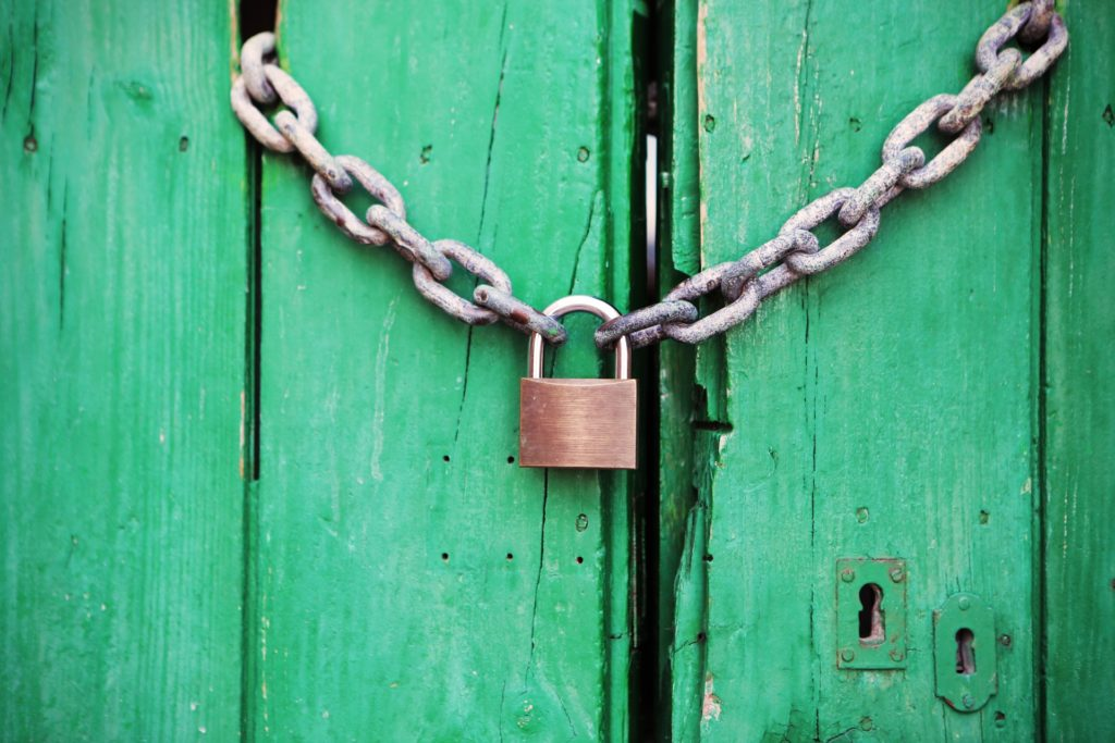 green door with closed lock and chain