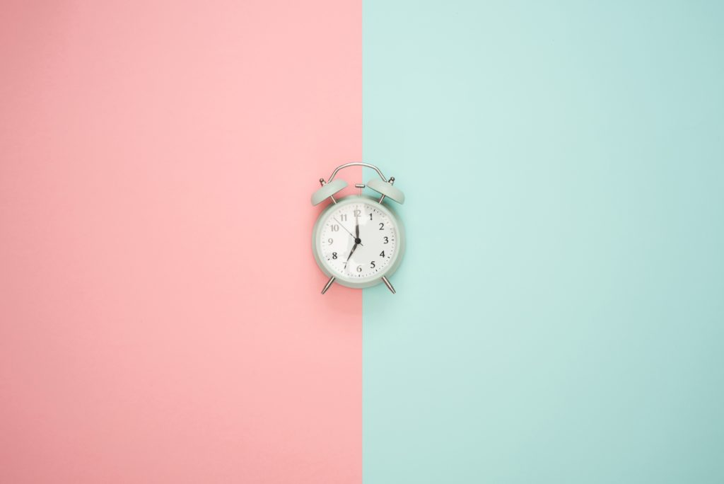 symmetrical abstract panels with clock in the middle
