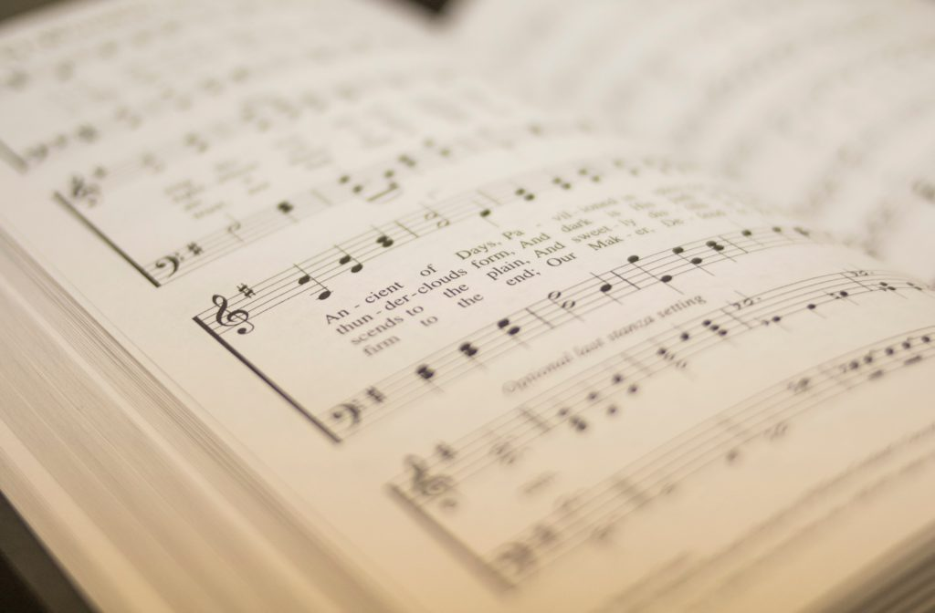open hymnal focused on old hymn text
