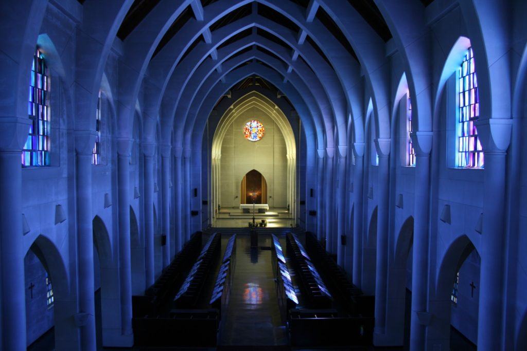 large cathedral with white walls and stained glass
