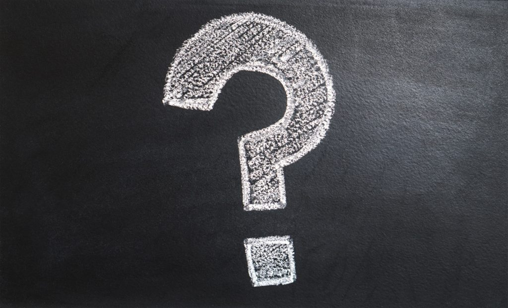 white block style question mark on blackboard